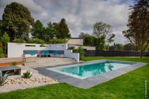 Aménagement paysager. Piscine. Spa. Solarium. Terrasse bois. Palmier. Jardins des 4 Saisons. Morbihan